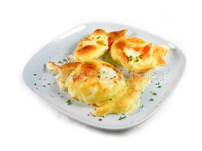 Patatas gratinadas con queso Emmental