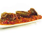 Carne de cocido con tomate y pimientos